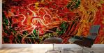 stampa adesiva murale con tema astratto di energia fluida in dominante di colore rosso con sfumature verdi su parete di studio