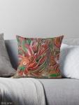cuscino da divano con motivo astratto di vortice fiammante dai toni di rosso, verde, bianco, nero, arancione e marrone